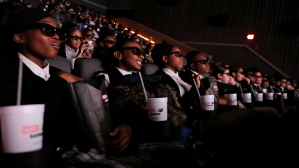 "Students from the Capital Preparatory Harlem School watch a screening of the film ""Black Panther"" on its opening night."