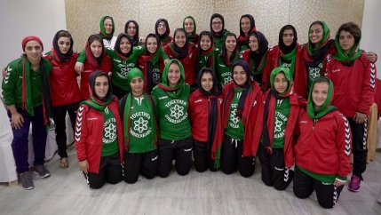 the Afghanistan Women's National soccer team poses in uniform