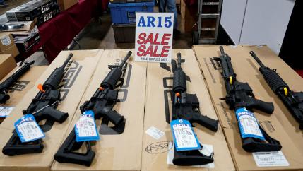 AR-15 rifles are displayed for sale at the Guntoberfest gun show in Oaks, Pennsylvania, Oct. 6, 2017.