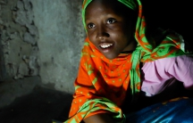 "Fourteen year-old Nuru Sheha studies at night in the light of solar-powered LED lights at home in the village of Matemwe, on the Tanzanian island of Zanzibar. He family's first electrical system was installed by one of Zanzibar's 13 ""solar mamas,"" illiter"