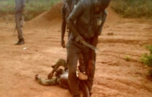 Screenshot of man beating another man, who is on the ground