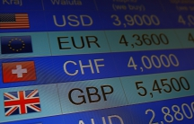 Rates of currencies, including British Pound, are displayed after Brexit referendum on an electronic board at a currency exchange in Warsaw, Poland.