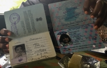Maya Rogers-Bursen, 26, holds her old Indian passport and a newer American one, each with different names.