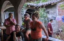 The family hangs out at their home in Sensuntepeque.