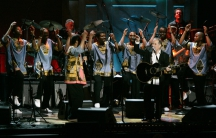Paul Simon, front right, performed with members of Ladysmith Black Mambazo for the first time in several years during a tribute at the Warner Theater in Washington on May 23, 2007.