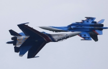 Sukhoi Su-27 Flanker fighters of the Russkiye Vityazi (Russian Knights) aerobatic show team are seen performing in 2015. Finland says Russian jets like these have probed its airspace.