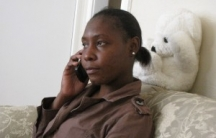 Carmine Pierre calls her 11-year-old son Marc Kelly in Haiti. She hasn't seen him since he was five. (Photo: Amy Bracken)