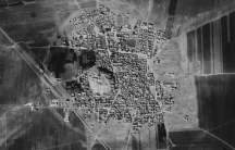 This 1961 satellite photo shows Tell Rifaat an ancient town in northwest Syria that is now completely surrounded by a modern town.