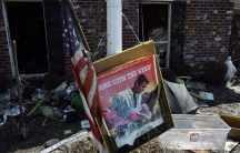 "A movie poster for ""Gone with the Wind"" sits in a front yard of a home damaged by Hurricane Katrina in Chalmette, Louisiana, in St. Bernard Parish September 28, 2005."