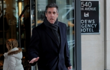 President Donald Trump's personal lawyer Michael Cohen exits a hotel in New York City.