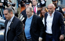 Film producer Harvey Weinstein, surrounded by NYC authorities, arrives at the 1st Precinct in Manhattan.