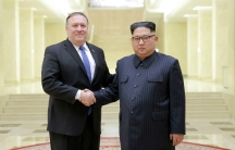 North Korean leader Kim Jong Un shakes hands with US Secretary of State Mike Pompeo in this undated photo released on May 9, 2018, by North Korea's Korean Central News Agency in Pyongyang. The same day, North Korea released three American prisoners, pavin
