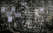 Signs advertise jobs on the wall of a bridge in Ikeja district in Lagos, Nigeria, Aug. 10, 2016.