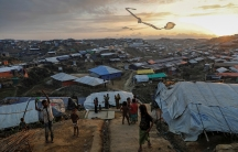 Rohingya refugee children fly improvised kites at the Kutupalong refugee camp near Cox's Bazar, Bangladesh.