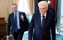Carlo Cottarelli arrives for a meeting with the Italian President Sergio Mattarella walk next to each other