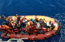 Migrants are brought aboard a Save the Children rescue boat