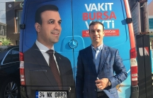 Muhammed Erdogan, the first Syrian turned Turkish citizen to run for parliament in Turkey, in front of his campaign truck.
