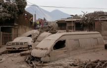 Rescue workers search for survivors and victims in the aftermath of Fuego volcano's eruption