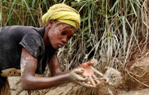 a woman working in a gold mine in the DRC