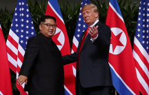 Presiden Donald Trump and leader Kim Jung-un meet at a historic summit.