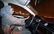 Hannan Iskandar drives her car in her neighborhood, in Al Khobar, Saudi Arabia, June 24, 2018.