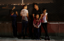 an asylum-seeking family from Honduras waits at the US/Mexico border.