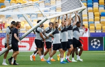 soccer team carrying the goalposts