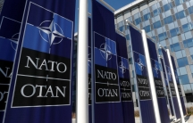 Banners displaying the NATO logo are placed at the entrance of new NATO headquarters, in Brussels.