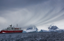 A ship carrying tourists plies the waters off Antarctica.