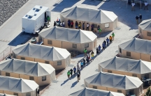 Immigrant children now housed in a tent encampment walk in single file at the facility near the Mexican border in Tornillo, Texas, June 19, 2018.