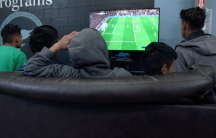Teenage boys play video games at Casa Padre, a facility for migrant children in Brownsville, Texas.