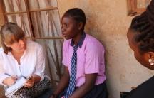 Author Anna Dahlqvist talking with Saudah, a teenager in Kampala, Uganda