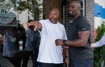 "Showrunner Cheo Hodari Coker and star Mike Colter talk on the set of ""Luke Cage."""