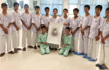 The Wold Boar soccer team and coach are in a Thai hospital after being rescued.