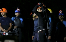 Thai divers gather before they enter to the Tham Luang cave, where 12 boys and their soccer coach are trapped, in the northern province of Chiang Rai, Thailand, July 6, 2018.