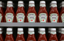 bottles of ketchup on a supermarket shelf