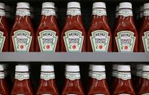 bottles of ketchup on a supermarket shelf