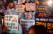 Anti-immigration activists attend a protest in the South Korean capital of Seoul on June 30, 2018. They were protesting against a group of hundreds of Yemeni asylum-seekers who arrived on the South Korean tourist resort of Jeju Island in recent months. Th