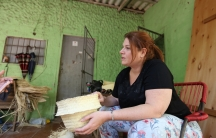 Alexandra Tauber talks to a countryside artisan in Paraguay.