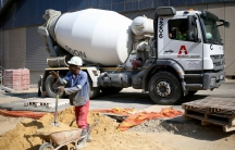Worker in front of cement truck