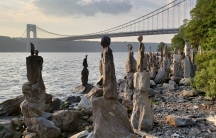 The Sisyphus Stones stretch out along the Hudson in Manhattan. They're the work of one man, Uliks Gryka, who has spent hours almost every day, erecting and maintaining them.