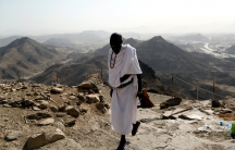 A muslim pilgrim climbs Mount Al-Noor
