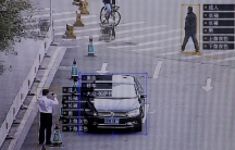 SenseTime surveillance software identifying details about people and vehicles showing the information layered on top of the screen.