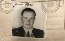 a 1949 visa photo of a man