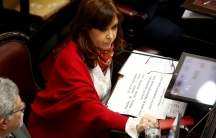 Senator and former Argentine President Cristina Fernandez de Kirchner sits next to Senator Marcelo Fuentes as lawmakers debated a bill that would have legalized abortion, in Buenos Aires, Argentina, August 9, 2018.