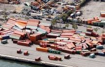 Shipping containers are shown fallen over on top of one another damaged by Typhoon Jebi..