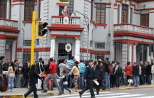 venezuelans gather outside their embassy in lima