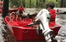 boats rescue pets from a flood