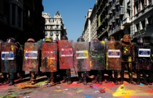 a police squadron covered in colorful powder