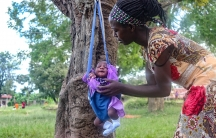 Mothers who attend nutrition classes in Matyebili, Uganda, have a chance to weigh their children